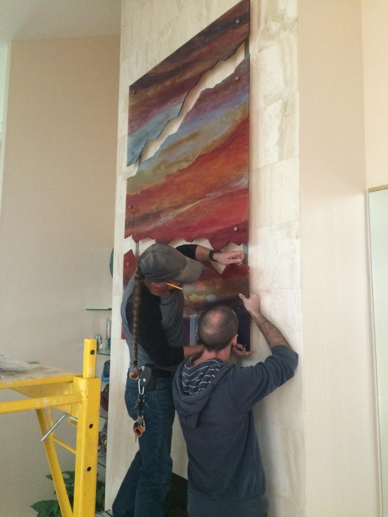 Ewan and Matt working on installing the final piece.