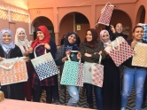 Amal girls showing off their hand painted bags!