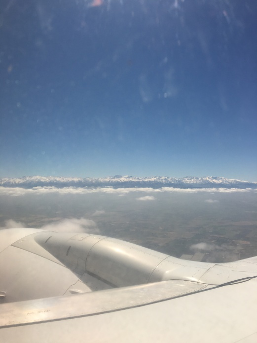 Lifting out of the clouds, homeward bound. Atlas mountains in the background
